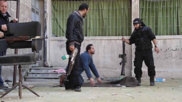free syrian army take target practice at a base in aleppo, syria. - イスラエルパレスチナ問題点の映像素材/bロール