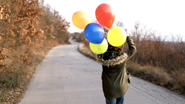 Free woman with balloons