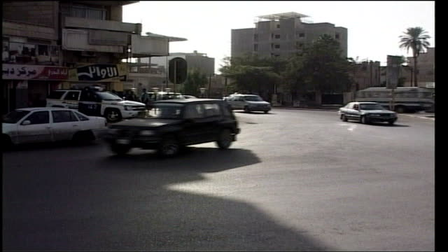 freed hostage norman kember approached to give evidence at kidnapping trial; iraq: baghdad: ext cars along on streets - kidnapping stock videos & royalty-free footage