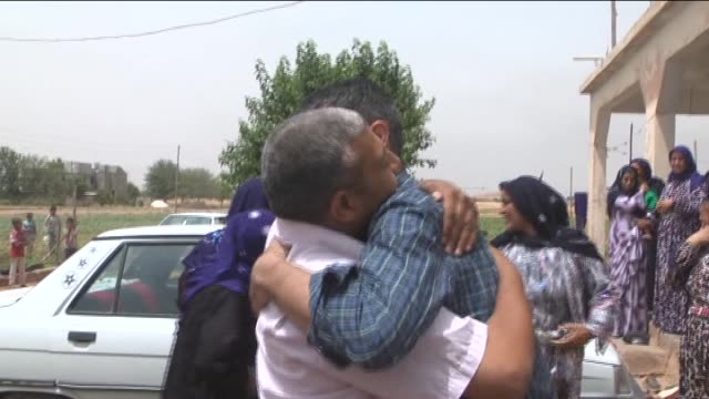 Freed Turkish truck driver who was prisoned in Arbil for 5 months is welcomed by his relatives in front of his house in Sanliurfa province Turkey on...
