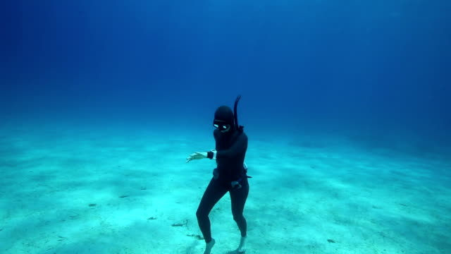 Freediver walking under the water