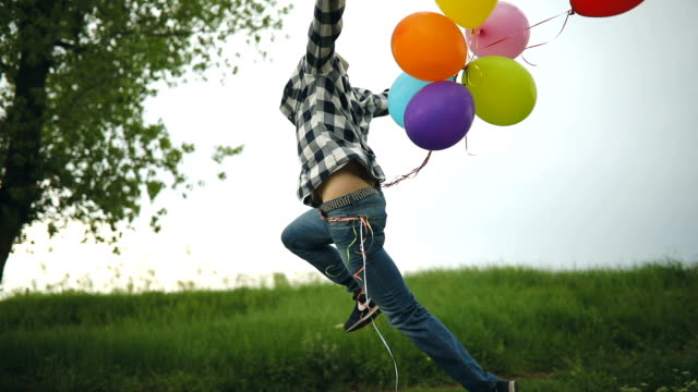 freedom and joy with the balloons - geek stock videos & royalty-free footage