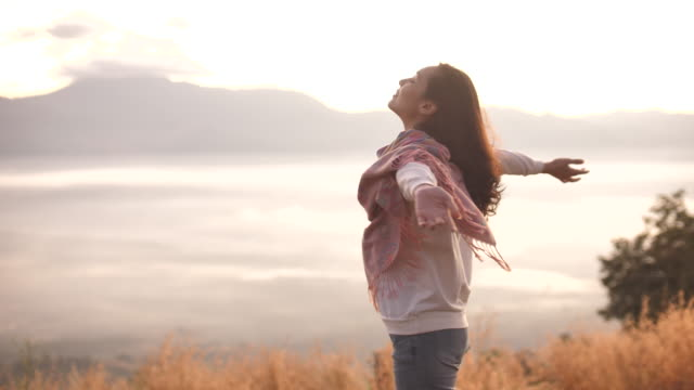 freedom asian woman open arms in sunlight on mountain - wide stock videos & royalty-free footage