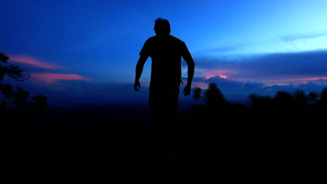 Freedom man at top of mountain , Slow motion