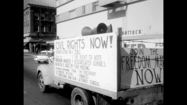 vídeos de stock e filmes b-roll de / freedom now movement truck drives through city streets with sound system calling for people to attendance the march on washington / organizers hand... - 1963