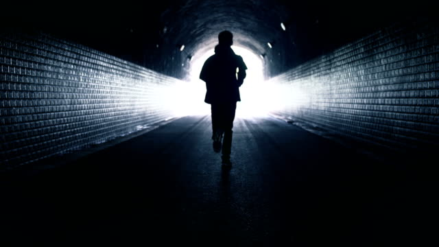 freedom running in dark tunnel - escapism stock videos & royalty-free footage