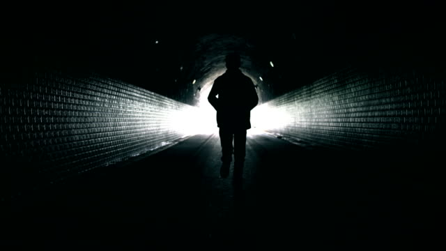 freedom running in dark tunnel - escaping stock videos & royalty-free footage