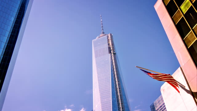 freedom tower and american flag - september 11 2001 attacks stock videos & royalty-free footage