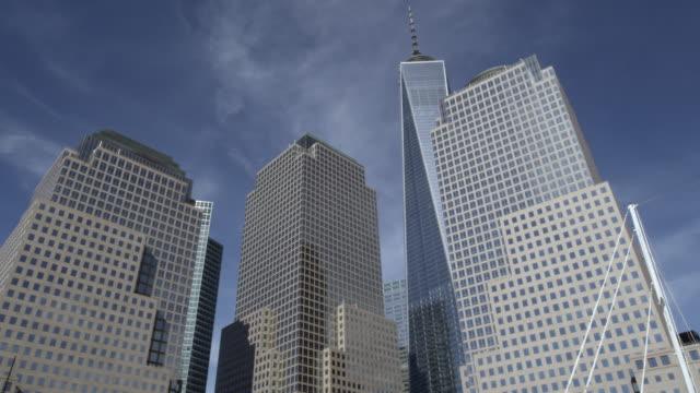 Freedom Tower in New York city with additional buildings day.