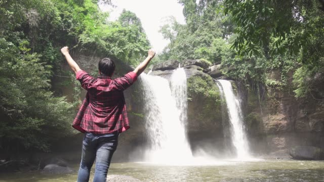 freedom travel, man enjoying with the waterfall - adventure stock videos & royalty-free footage