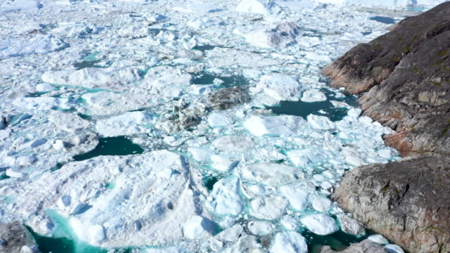 freefloating ice lies jammed into the ilulissat icefjord during unseasonably warm weather on july 30 2019 near ilulissat greenland the sahara heat... - western europe stock videos & royalty-free footage