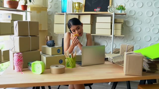 sme freelance man working with box, young business owner home office, online marketing packaging box and delivery, sme and delivery e-commerce concept.start up small business entrepreneur. - multitasking stock videos & royalty-free footage