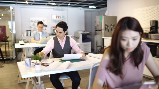 freelance multi-ethnic group of people working together in rented office - copy space stock videos & royalty-free footage