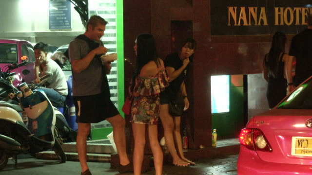 freelance sex workers talk and wait for customers in the nana section of bangkok on the day the government relaxed mourning restrictions the king of... - nutten stock-videos und b-roll-filmmaterial