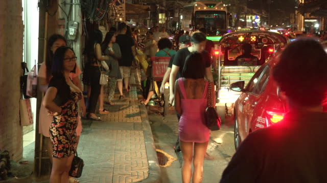 freelance sex workers wait for customers in the nana section of bangkok on the day the government relaxed mourning restrictions the king of thailand... - nutten stock-videos und b-roll-filmmaterial