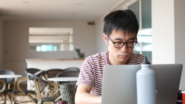 freelancer working remotely - handsome people stock videos & royalty-free footage