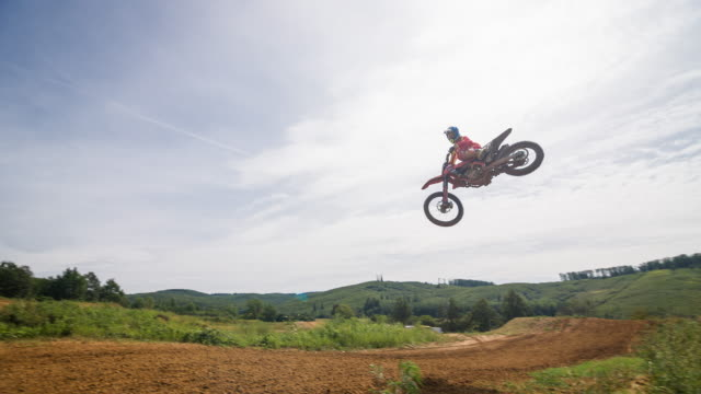 freestyle motocross rider performing a stunt - stunt stock videos & royalty-free footage