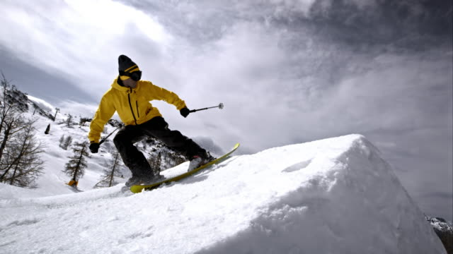 slo mo ts freestyle skier flying off the jump - skiing stock videos & royalty-free footage