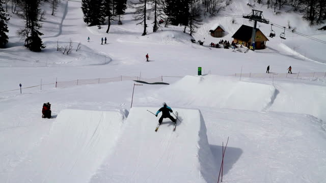 Freestyle skier jumps in snow park