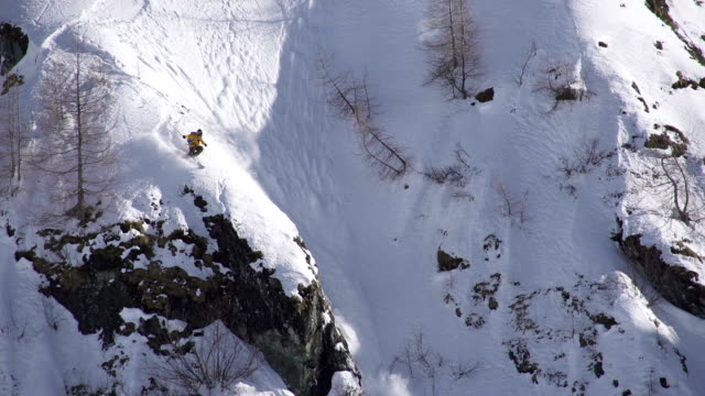freestyle skier jumps off a cliff into an avalanche - cliff stock videos & royalty-free footage