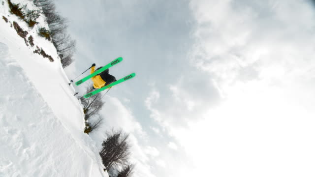 slo mo ts freestyle skier performing a backflip - goggles sportswear stock videos and b-roll footage