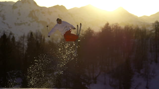 freestyle skier performing a trick at sunset - stunt stock videos & royalty-free footage