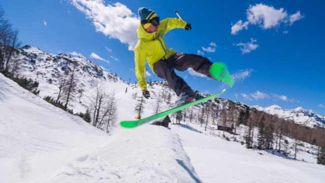 freestyle skier performing jump stunt in a snow park - snowboarding stock videos & royalty-free footage