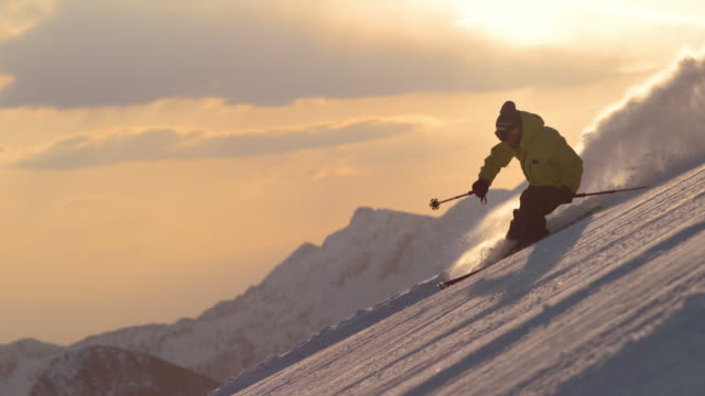SLO MO TS Freestyle skier skiing at sunrise