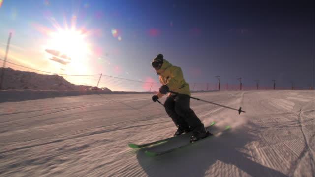 SLO MO TS Freestyle skier skiing at sunset