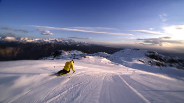 slo mo ts freestyle skier skiing down slope - winter sport stock videos & royalty-free footage
