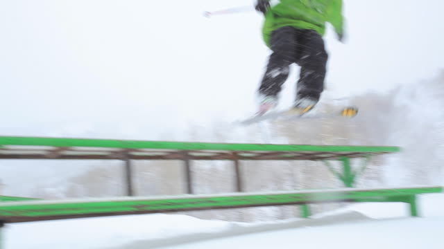 A freestyle skier slides across a table-like rail at Terrain Park in Park City, Utah.