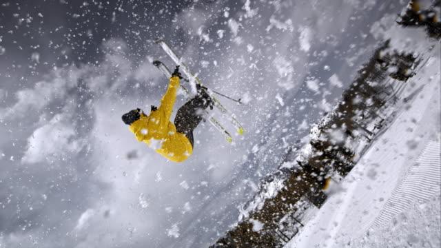 SLO MO Freestyle skier spraying powder snow before jumping