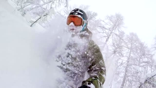 tw freestyle snowboarder in the wilderness on snowy day - powder snow stock videos and b-roll footage