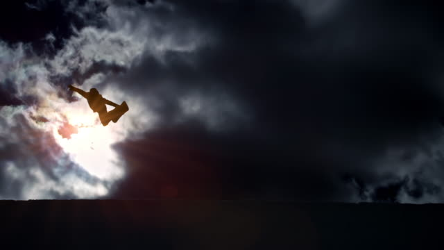 slo mo freestyle snowboarder jumping in the half-pipe with clouds in the background - balance stock videos & royalty-free footage
