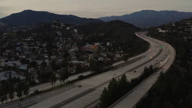 2 freeway as the sun is setting - drone shot - empty road stock videos & royalty-free footage