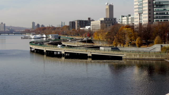tl freeway at charles river with fall foilage. - river charles stock videos & royalty-free footage