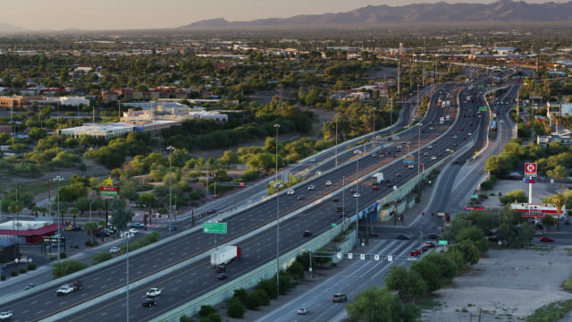 freeway cutting through downtown tucson - aerial view - arizona stock-videos und b-roll-filmmaterial