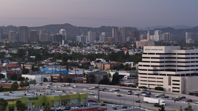 stockvideo's en b-roll-footage met 405 freeway in west los angeles with westwood in background - aerial shot - westwood los angeles