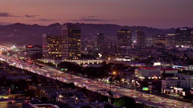 405 freeway in west los angeles with westwood skyline at dusk - aerial shot - westwood neighborhood los angeles stock videos & royalty-free footage