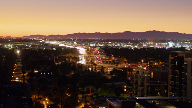 freeway on edge of downtown phoenix at nightfall - aerial view - dusk stock videos & royalty-free footage