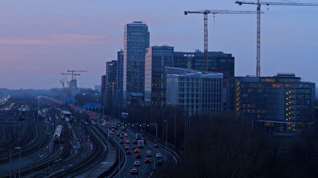 freeway through the zuid-as amsterdam business district - twilight stock videos & royalty-free footage