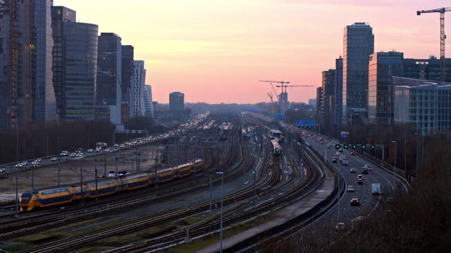 freeway through the zuid-as amsterdam business district - dusk stock videos & royalty-free footage