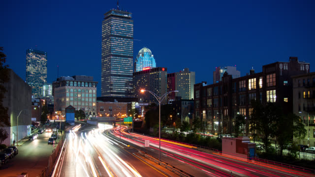 t/l   freeway traffic and skyscrapers in boston at night - boston stock videos and b-roll footage