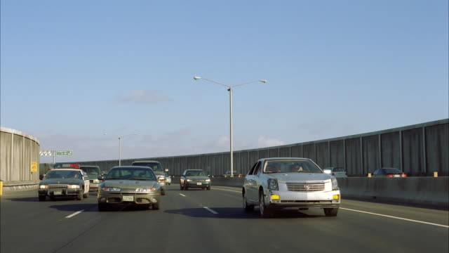 slo mo pov ws freeway traffic, car exploding and crushing into other vehicles - 衝突事故点の映像素材/bロール
