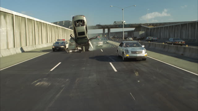 SLO MO REAR POV Freeway traffic, cars flipping and crashing