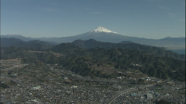 A freeway winds through a community in the foothills of Mt. Fuji.