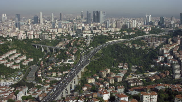Freeway Winds Through Istanbul Among Skyscrapers