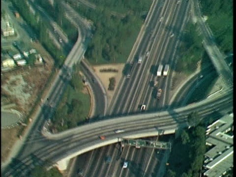 vidéos et rushes de 1970 montage aerial freeways and downtown district, los angeles, california, usa, audio - 1970