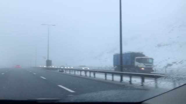 stockvideo's en b-roll-footage met freezing fog seen on the m62 between manchester and liverpool as severe weather hit the area snowfall brought manchester and liverpool airports to a... - bevroren