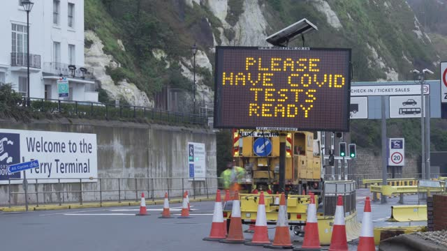 freight arriving at dover port with a sign saying 'please have covid tests ready' due to eu restrictions of people leaving the united kingdom on... - video stock videos & royalty-free footage
